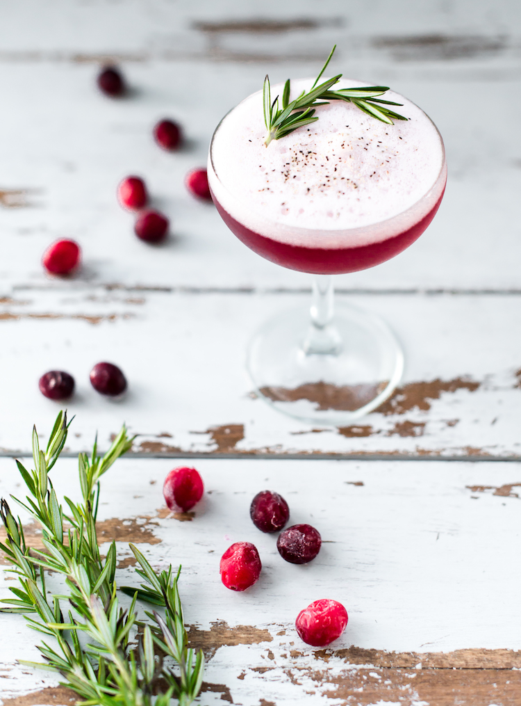 Pepper & Berries cocktail with cranberry and rosemary// craftandcocktails.co