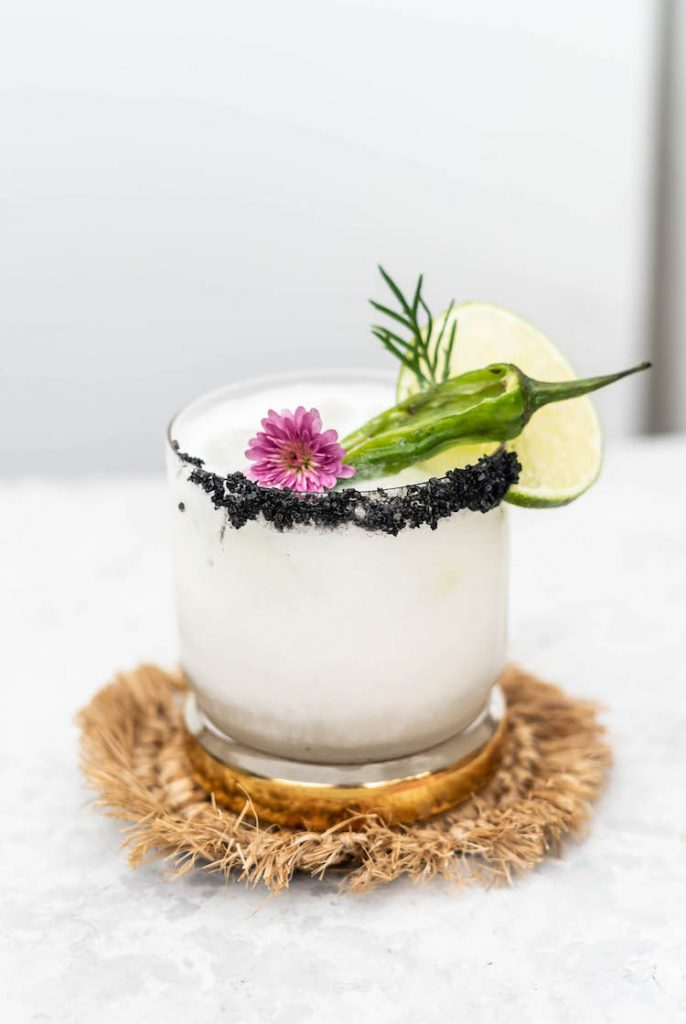 The Coconut Jalapeño Margarita is a spicy, tropical twist on the classic tequila cocktail. Spicy jalapeño is tempered by cooling coconut for a refreshing, but zippy sip.